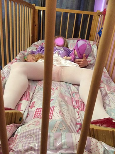 Adult Baby in Cot