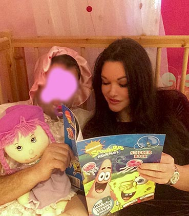 Nanny Betty Reading to an Adult Baby