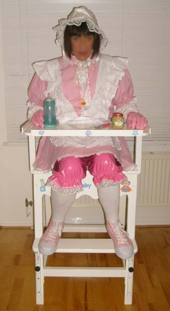 A big Sissy Adult Baby Girl in the highchair at Nanny Betty's Nursery in Chigwell, Essex-London UK