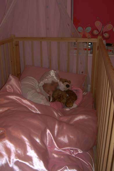 Adult baby asleep in Cot at Nanny Betty's Adult Baby Nursery Chigwell, Essex London UK
