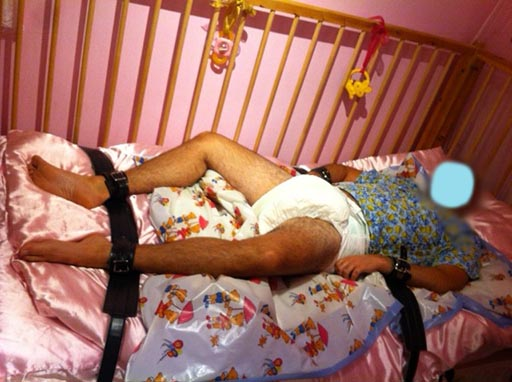 Adult Baby in Cot Restraints